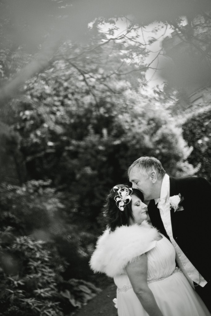 Groom tenderly kissing his bride's forehead, Lancashire wedding photography