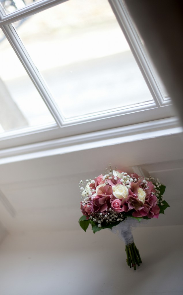 Bridal bouquet, sat in a window ledge creative
