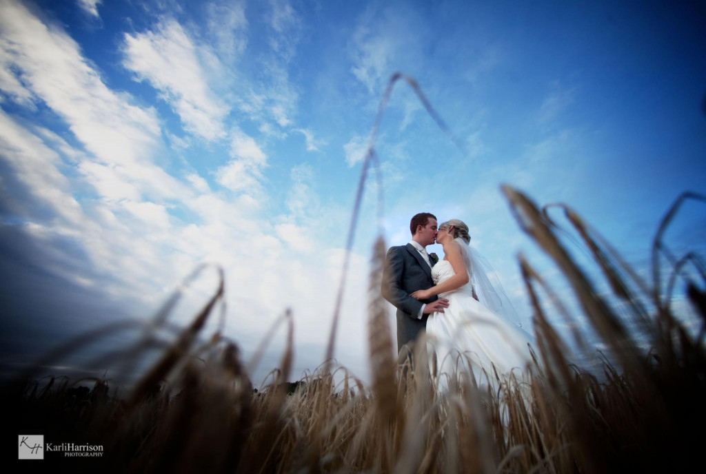 Looking up at the bride and groom with wide angle lens, Lancashire wedding photography