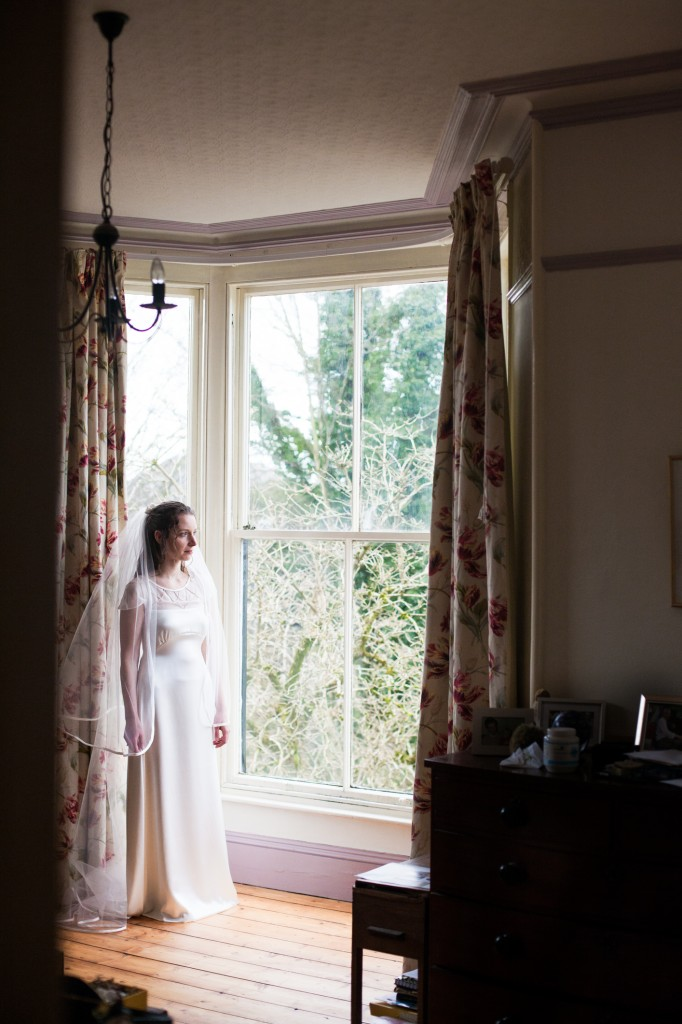 Bride standing in window - Lake District