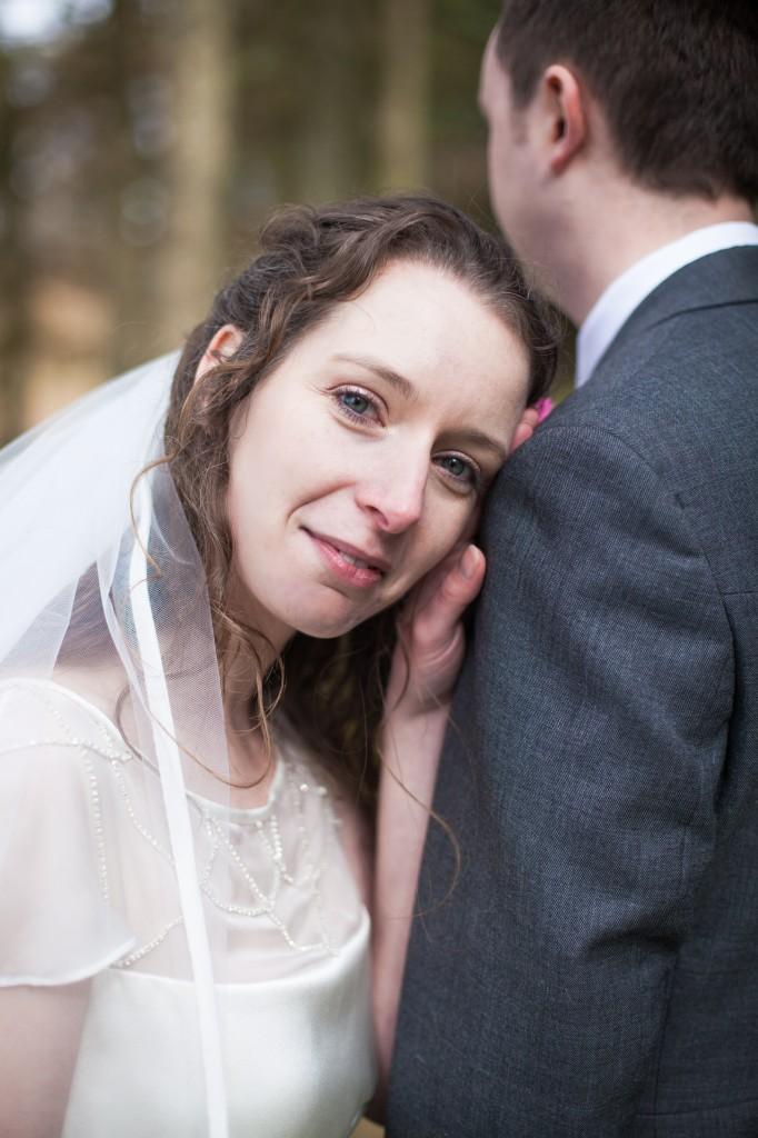 Bride resting her head on shoulder