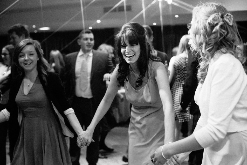 Guests laughing during wedding reception