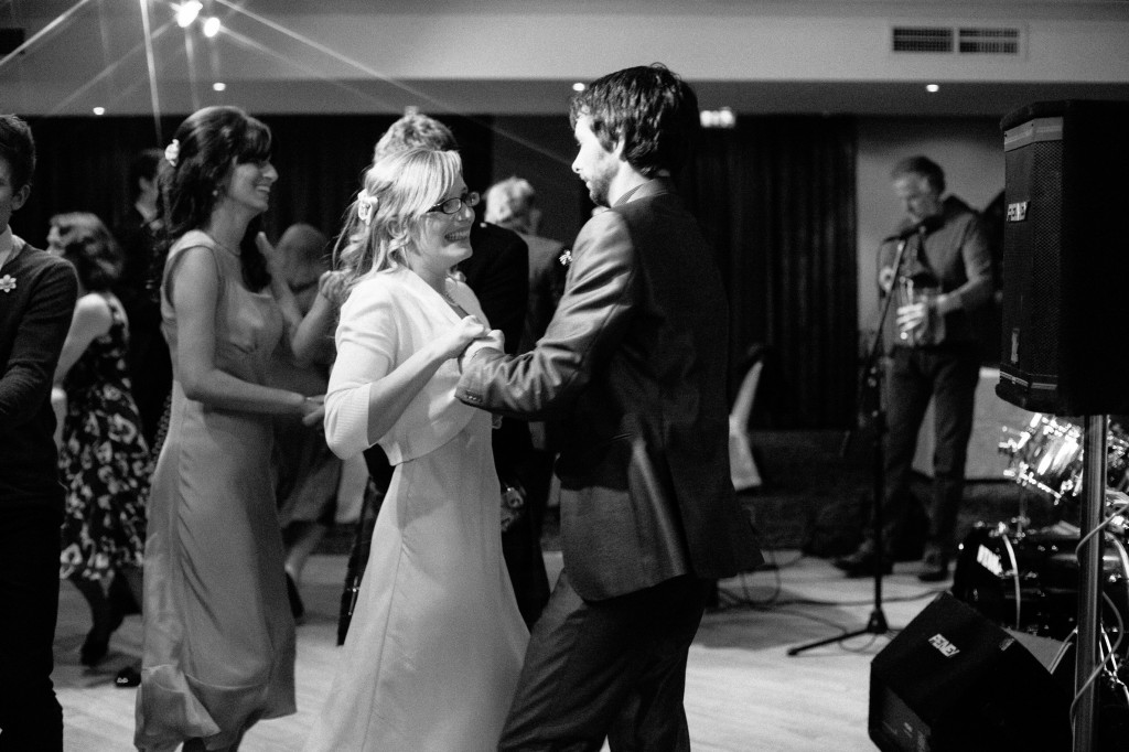 Wedding guests laughing, dancing