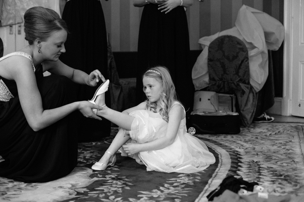 Bridesmaid having shoes put on