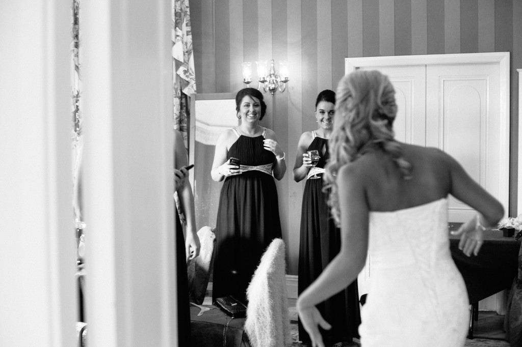 Bridesmaids see Bride first time with dress on