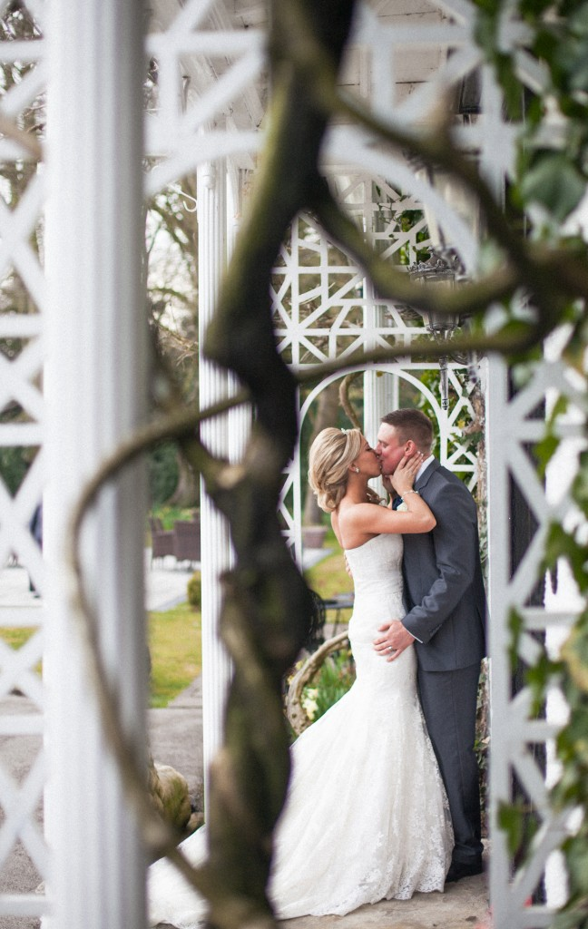 Bride and groom kissing photograph