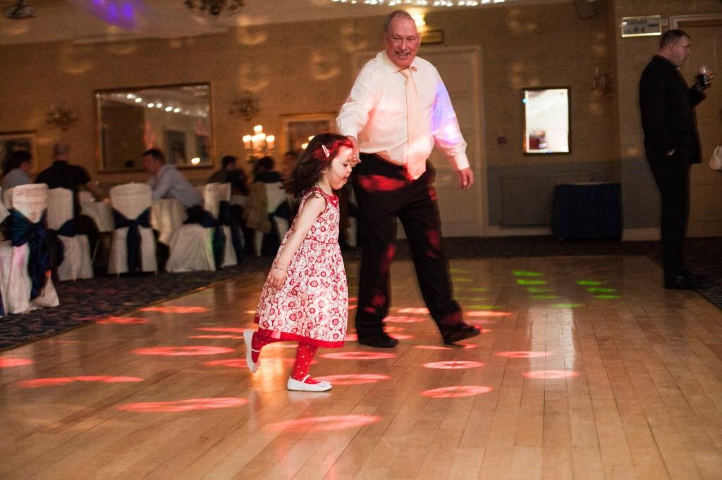 Little girl running on dancefloor