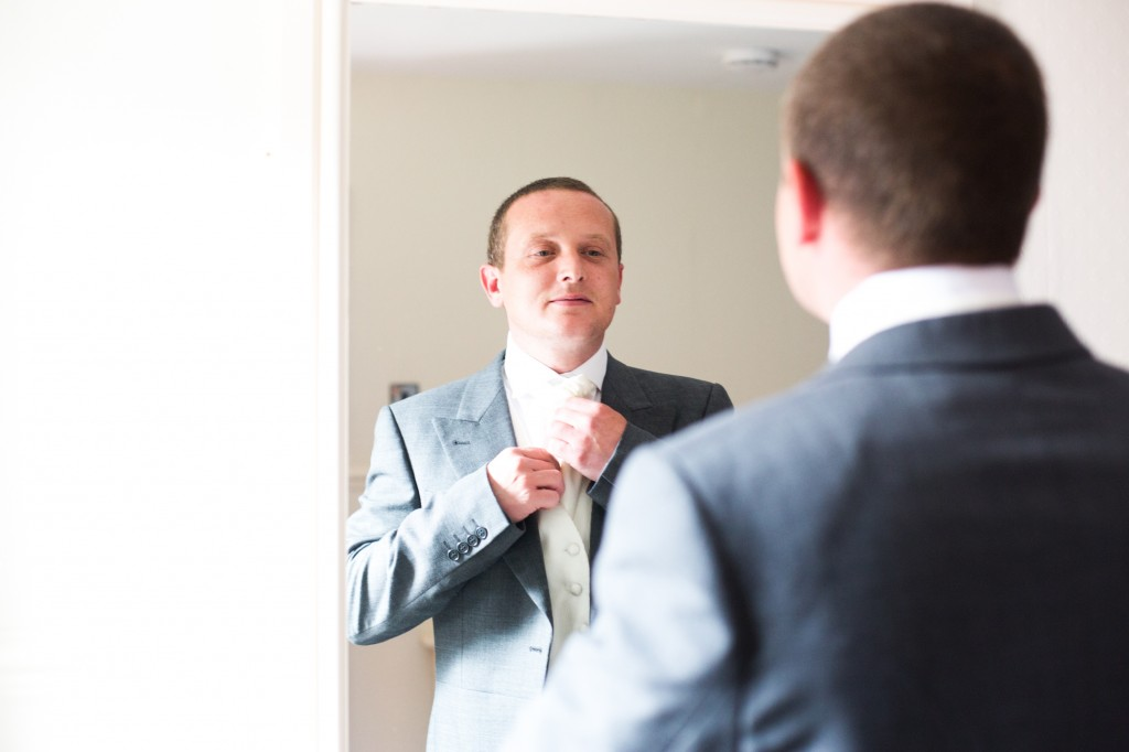 A groom gets ready in his room at Gretna Green