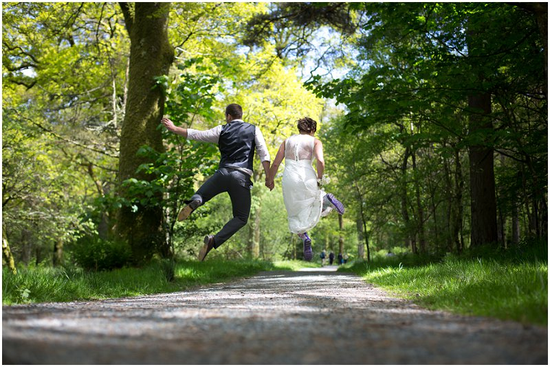 A couple jumping in the air Cumbria Wedding photography