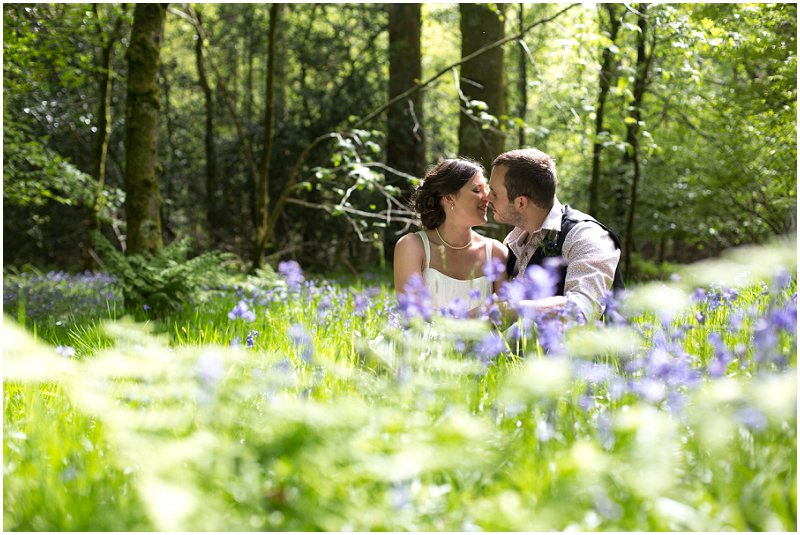 A couple sit in Bluebells wedding photography