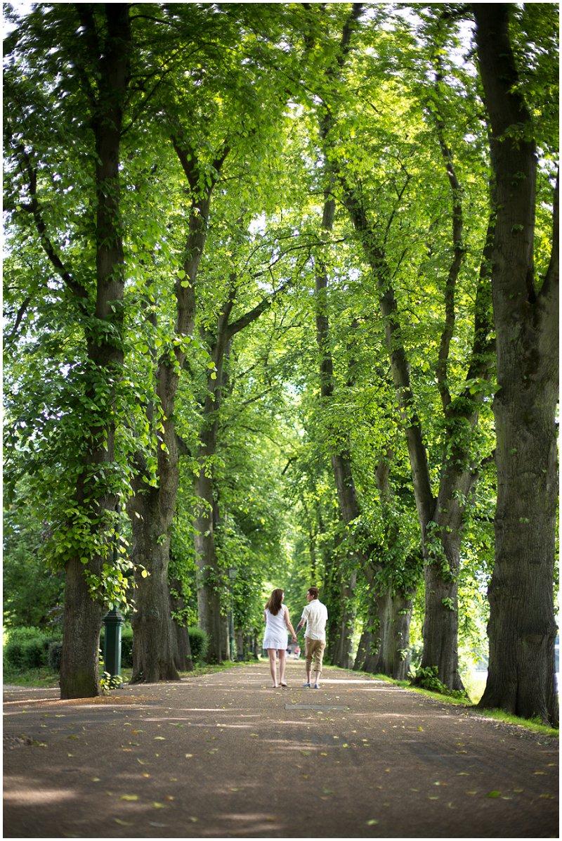 A couple walking during pre wedding shoot Preston