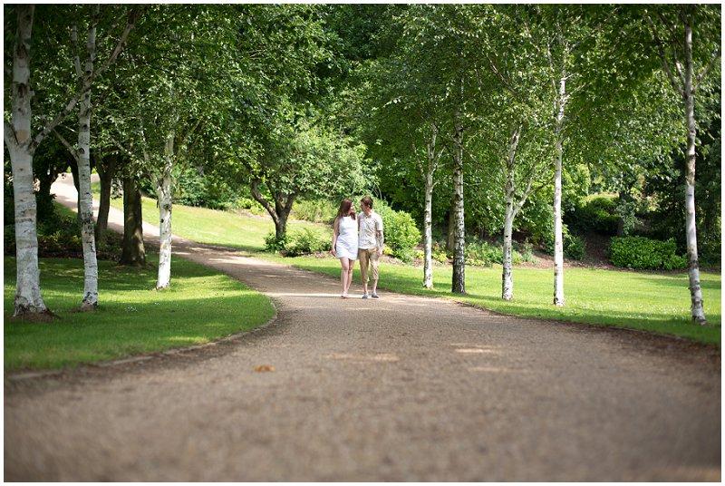Couple walking during pre wedding shoot Lancashire
