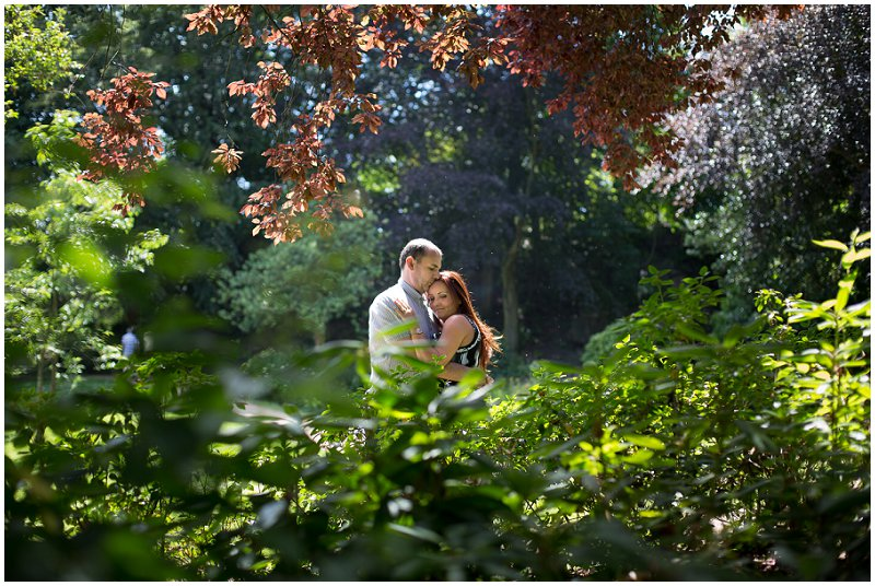 Couple embrace in Preston Park