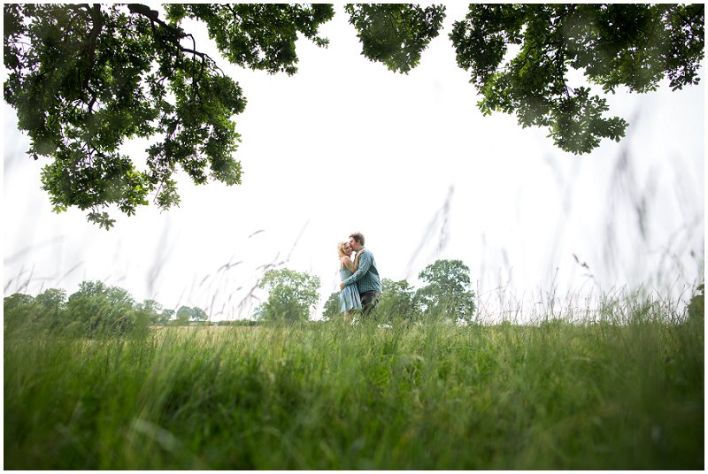 Bride and groom in field during pre wedding shoot at Sandhole