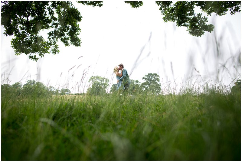 Bride and groom to be in fields at Sandhole Oak Barn, Cheshire