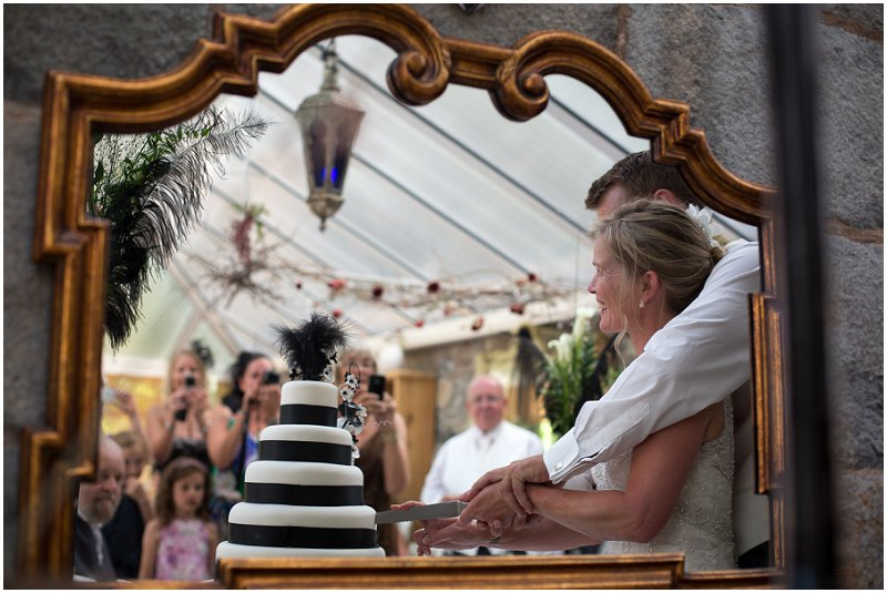 Bride and groom cutting the cake at Wedding in Wales