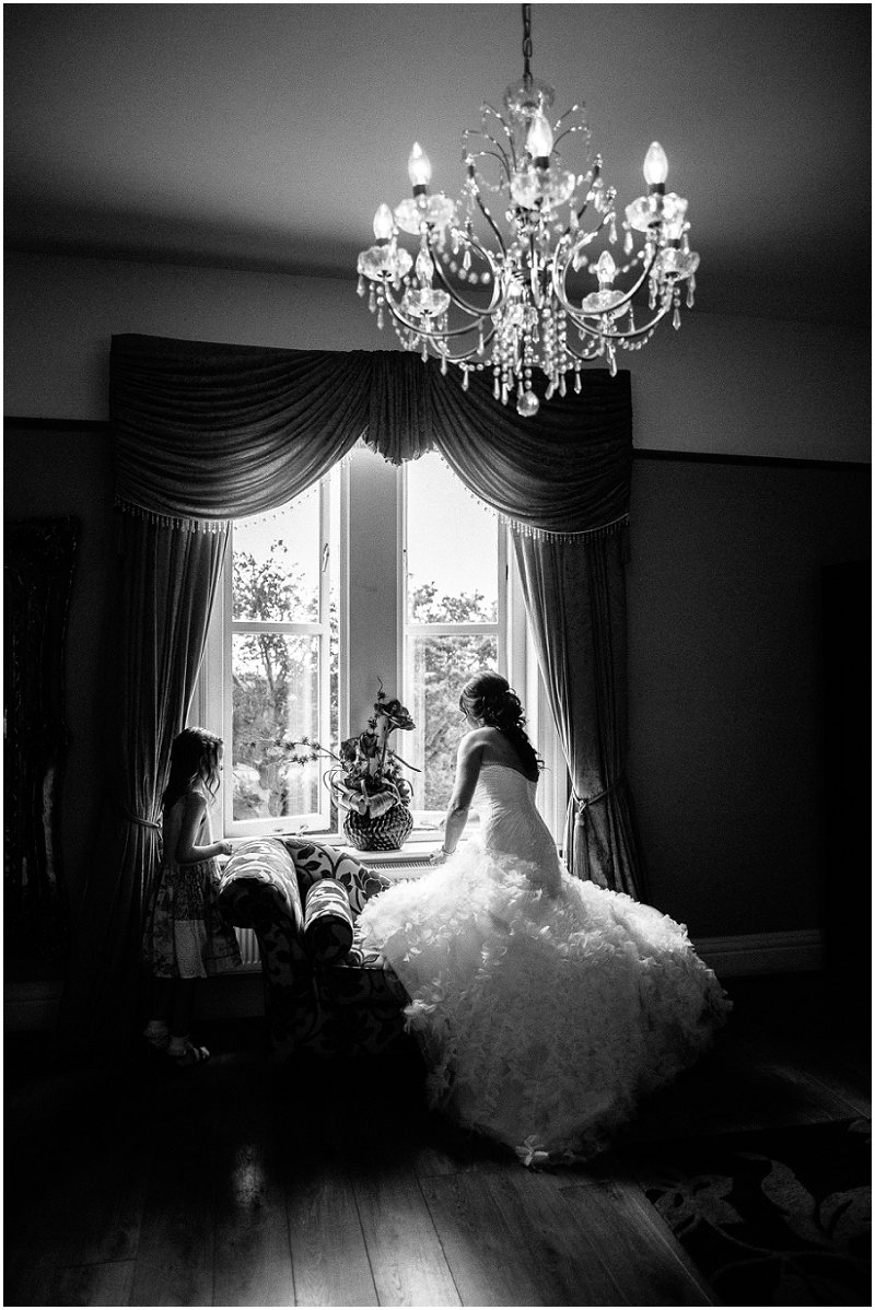 Bride looks out window at West Tower Lancashire Photography