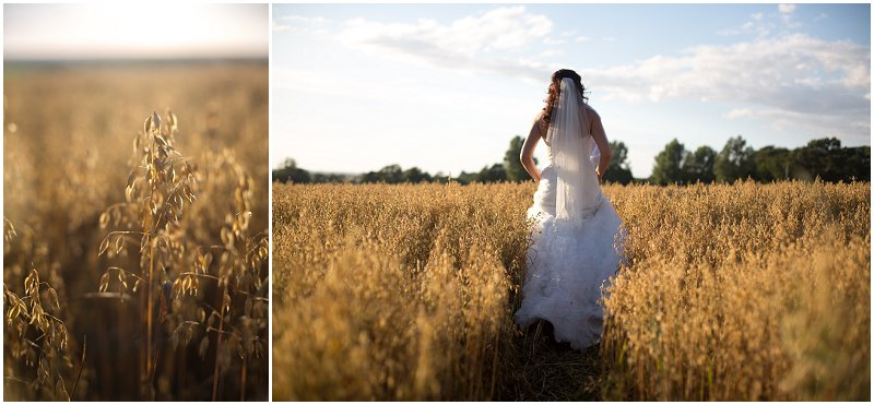 Bride walking through fields at West Tower Wedding Photography