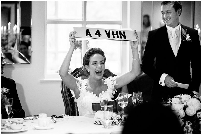 Bride holds up personalised license plate