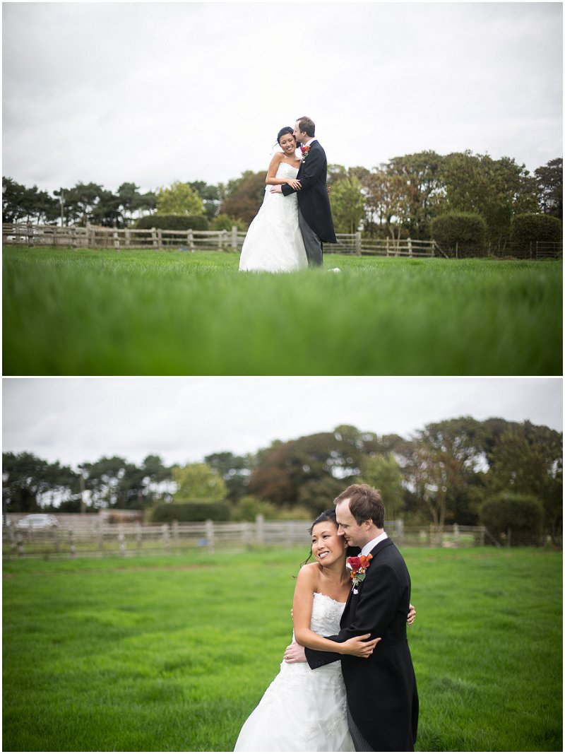 Kissing in a field at The Villa | Lancashire Wedding Photography
