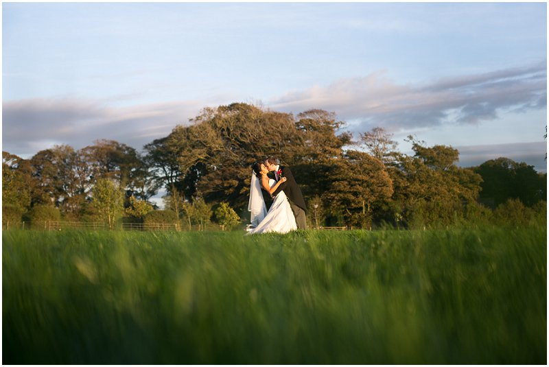Kiss the Bride | A field at The Villa Lancashire Wedding Photography