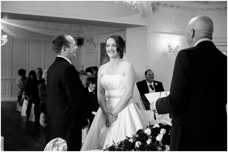 Couple laughing during ceremony at Eaves Hall