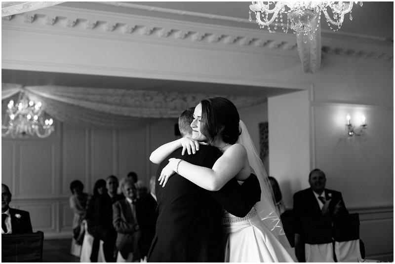 Bride and groom hug at Eaves Hall Lancashire