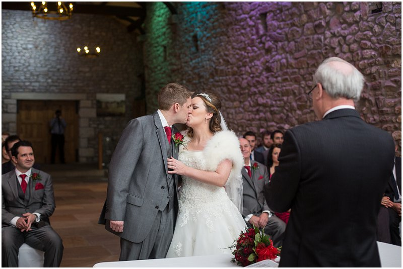 Married Couple Kissing at Tithe Barn Lancashire