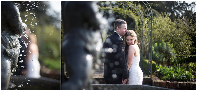 The fountain | a bride and groom pose next to fountain in Birtsmorton Court