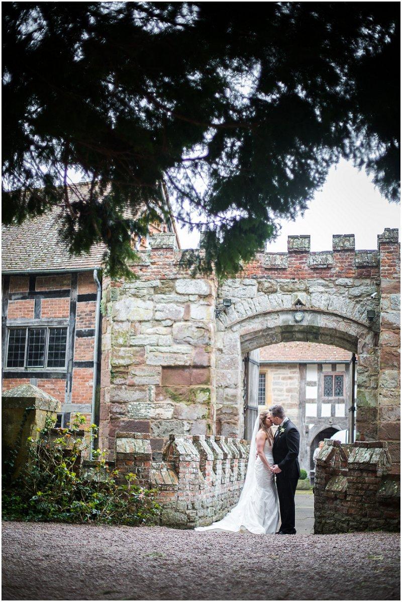 Couple kiss in Birtsmorton Court Grounds | Wedding Photography