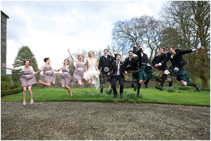 Bridal Party jumping in the air at Belmount Hall