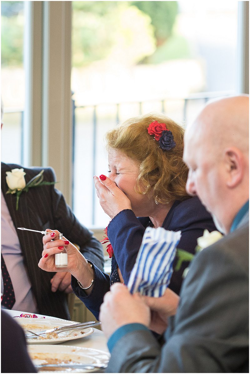Guest bursts out laughing after blowing bubbles | The Alma Inn Wedding Photographer