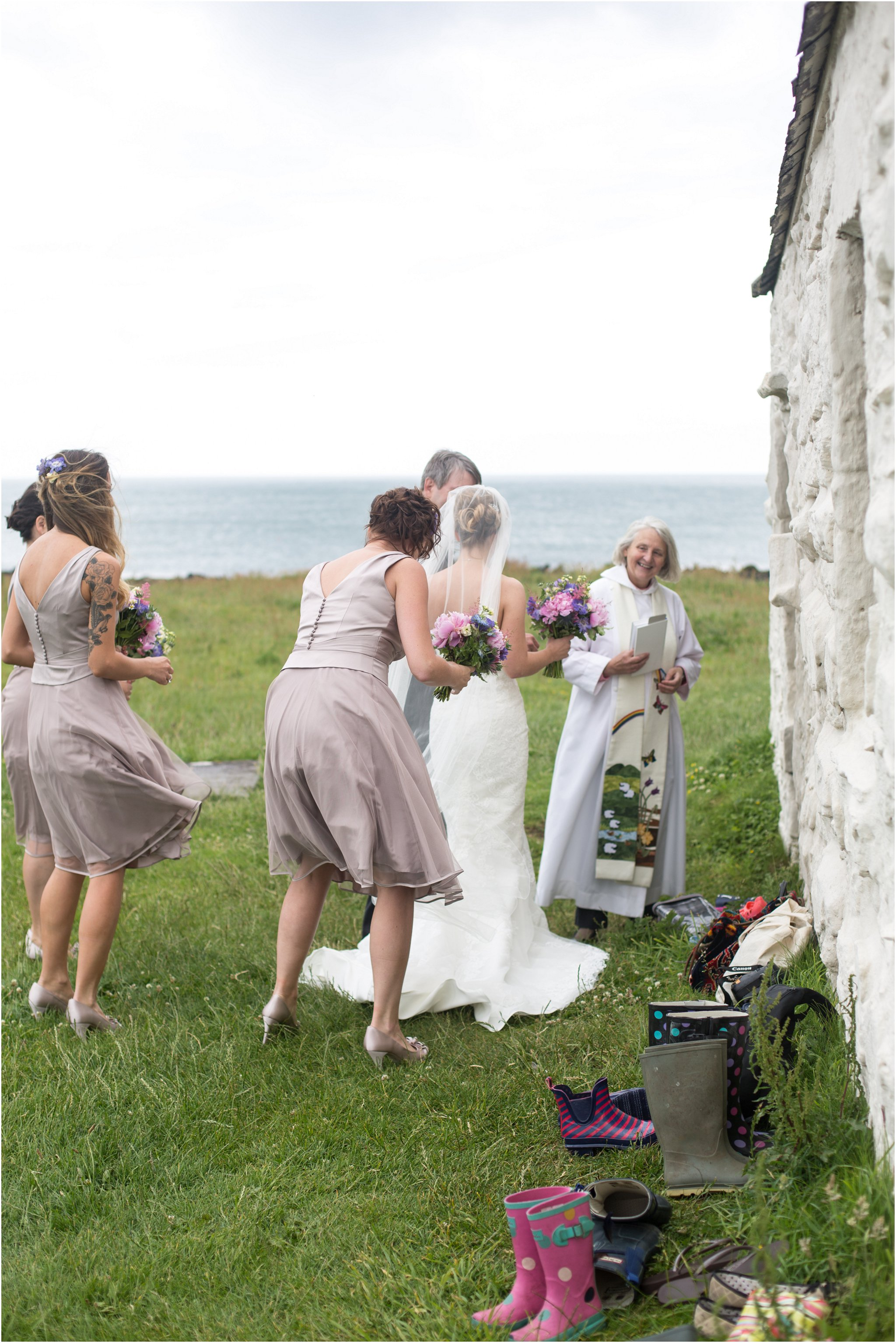Bride enters the Church on the Sea at Anglesey Wedding Photographer
