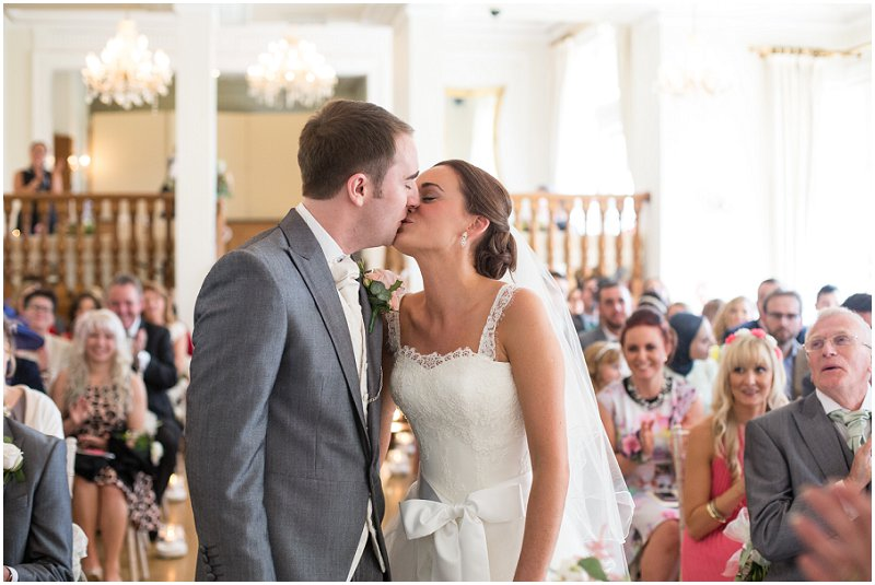 You may kiss the bride! Ceremony ends at West Tower Wedding venue Lancashire