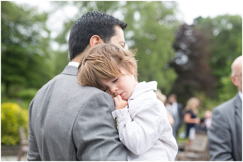 Guests child sleeping at wedding at Linthwaite House Hotel, Cumbria
