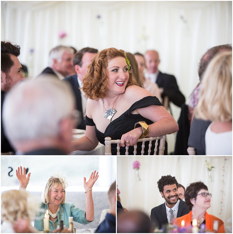 Guests enjoying speeches at wedding in Anglesey