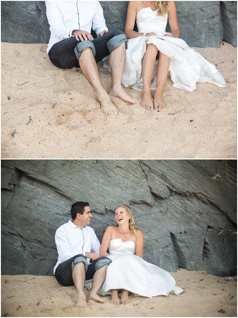 Sitting in Cornwall sand a bride and groom in love