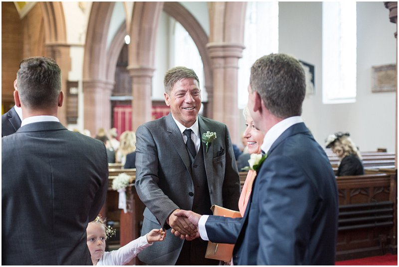 Groom greeting guests at Church wedding, mellor