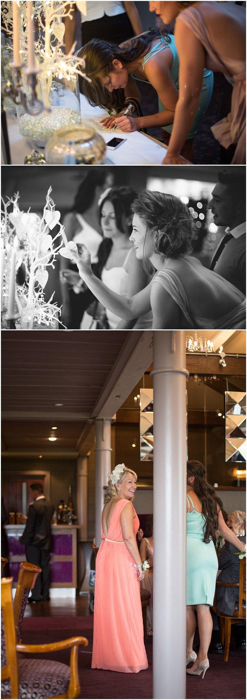 Guests sign wish tree at wedding