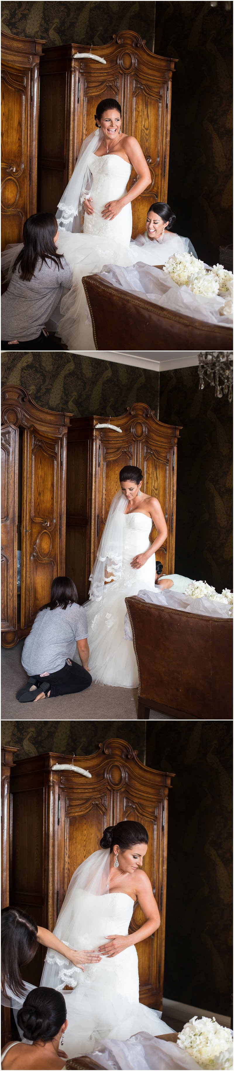 Bride getting into dress at Eaves Hall, Lancashire