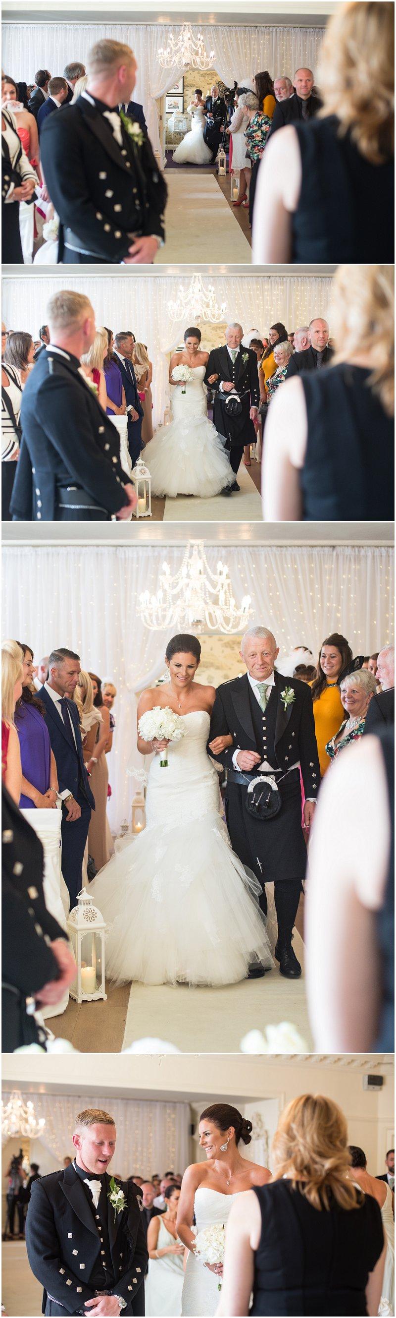 Bride walking down aisle at Eaves Hall Lancashire