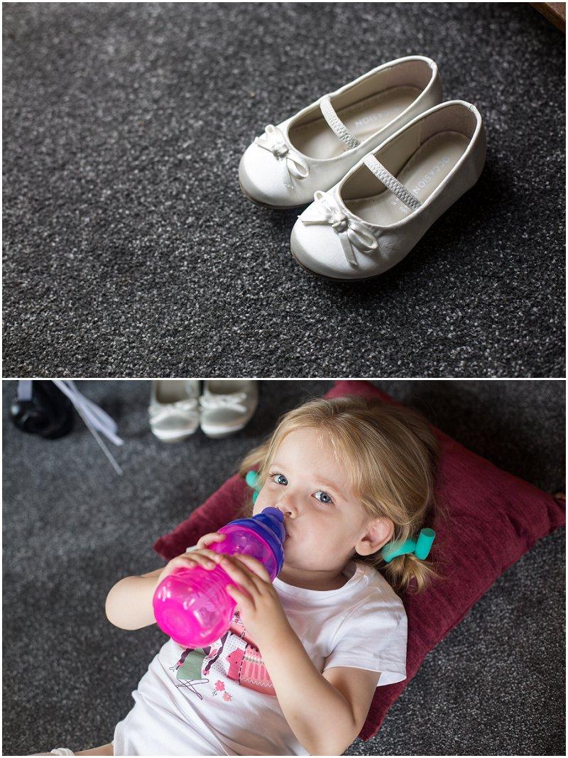 Little flowergirl at her parent's wedding in Bury