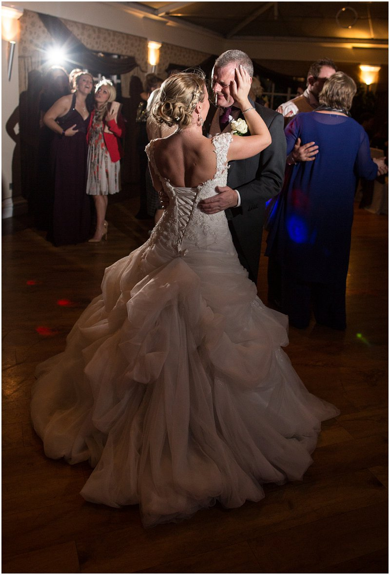 Father of the Bride dances with the Bride during emotional wedding reception Cheshire Photographer