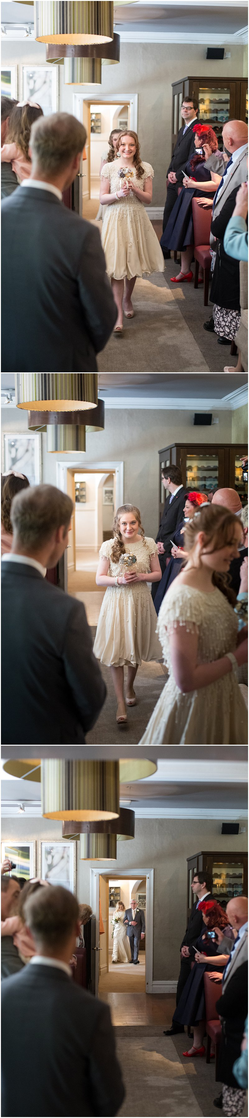 Bridesmaids and bride walk up aisle at Linthwaite House Hotel Wedding