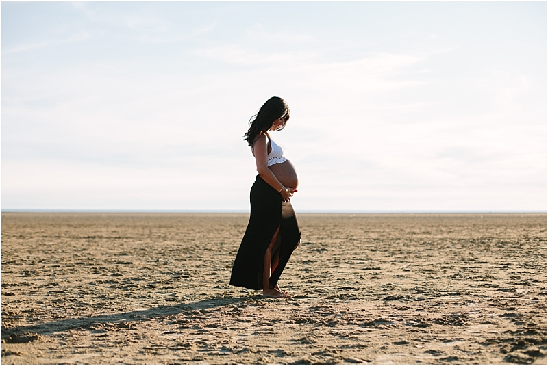Gorgeous pregnant woman on the beach during shoot