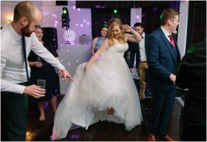 Bride dancing at Wedding Wales