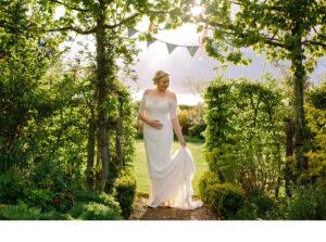 Bride backlit in Garden photography
