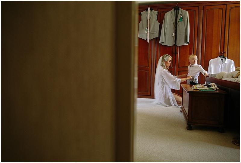 Bride getting son ready for Wedding